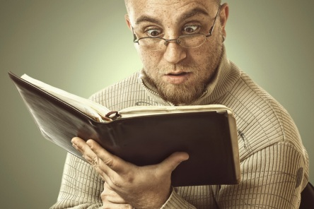 confused-man-reading-book